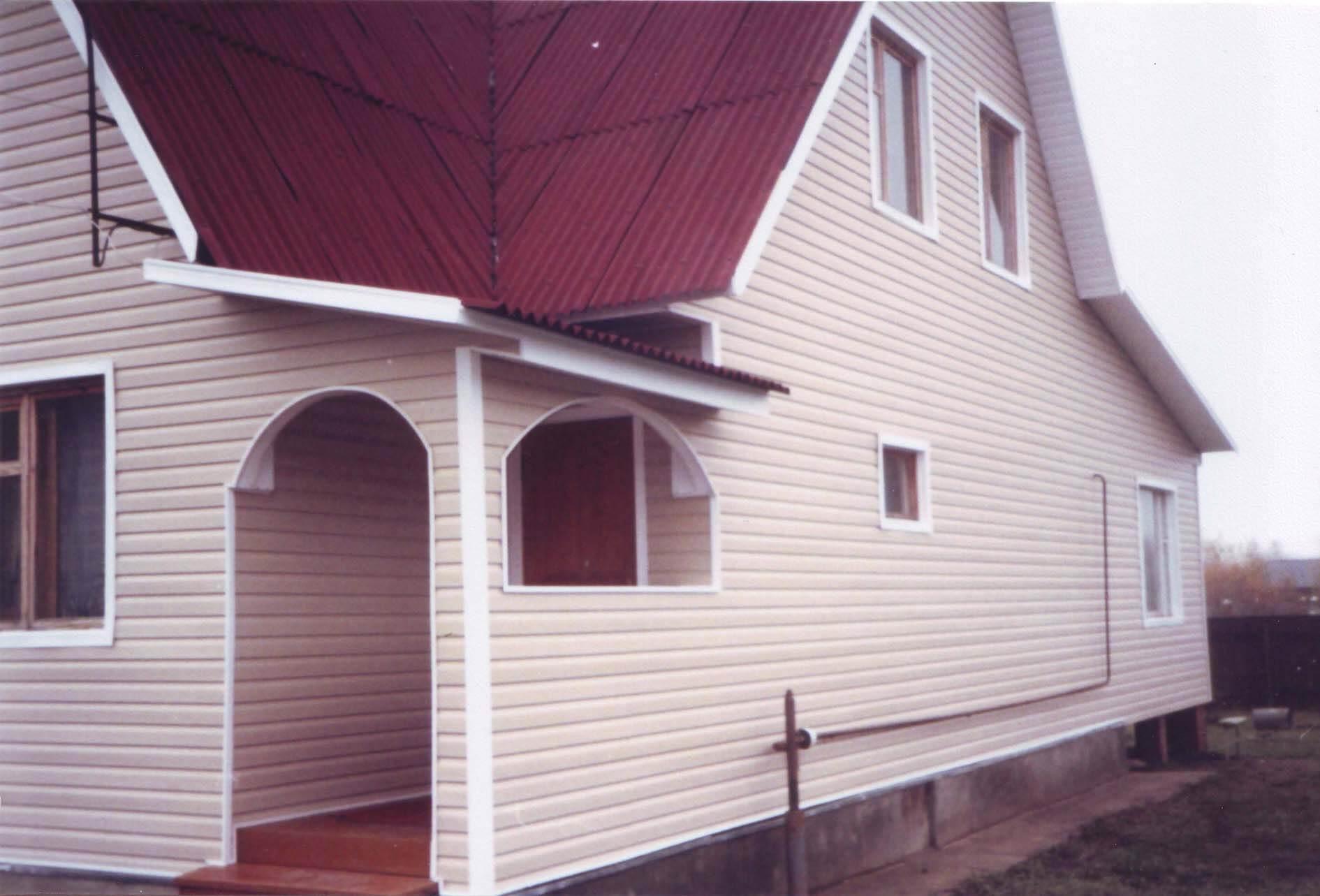 Фото фасадов с отделкой короедом