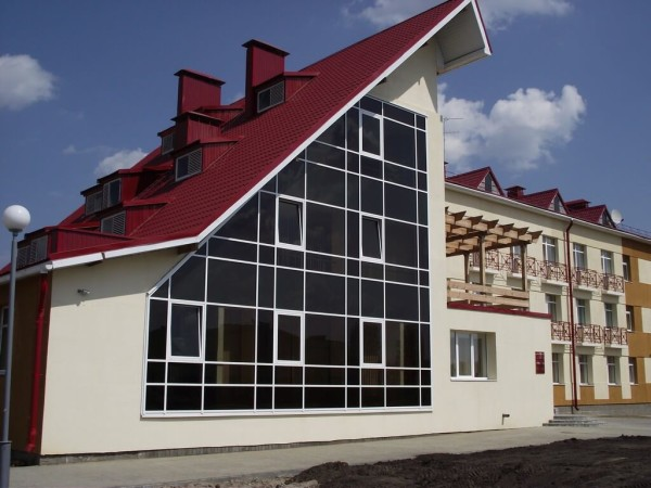 Отделка фасада стеклопанелями, цена в Минске