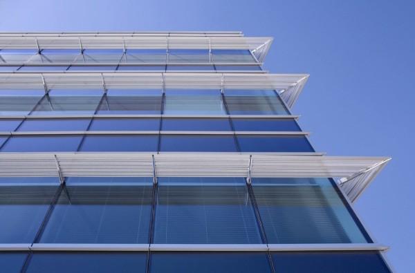 Фасад из стеклопанелей, цена отделки дома